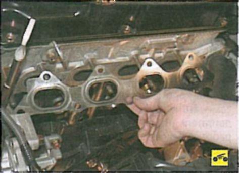 замена прокладки коллектора лансер 10